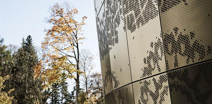 Perforated sheets create a dramatic facade