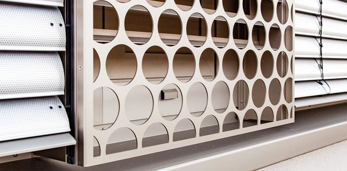 Perforated sheets designed to depict a spring forest
